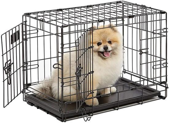 Afbeelding van kleine zwarte Topmast hondenbench met hondje erin