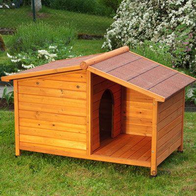 Afbeelding van het Hondenhok Spike Special buiten in de tuin