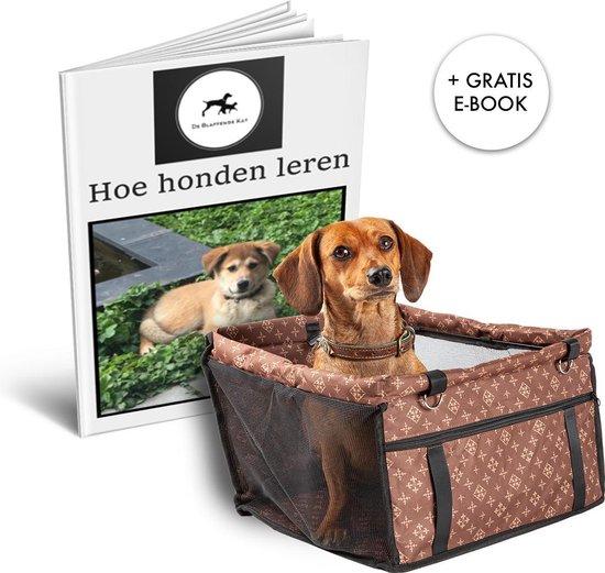 Afbeelding van hondje in een hondenmand met boek